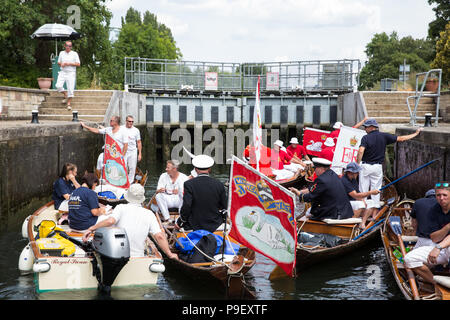 Shepperton, UK. 16th July, 2018. Swan Uppers pass through Chertsey Lock on the River Thames during the first day of the Swan Upping census. Swan Upping is an annual five-day ceremonial swan census requiring the gathering, marking and releasing of all cygnets, or mute swans, on the River Thames. It dates back more than 800 years, to when the Crown claimed ownership of all mute swans. The first day of the census takes place between Sunbury and Windsor. Credit: Mark Kerrison/Alamy Live News - Stock Photo