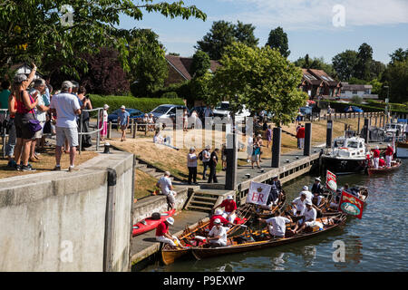 Shepperton, UK. 16th July, 2018. Swan Upping vessels pass through Shepperton Lock on the first day of the annual five-day ceremonial Swan Upping census on the river Thames. Swan Upping requires the gathering, marking and releasing of all cygnets, or mute swans, on the river. It dates back more than 800 years, to when the Crown claimed ownership of all mute swans. The first day of the census takes place between Sunbury and Windsor. Credit: Mark Kerrison/Alamy Live News - Stock Photo