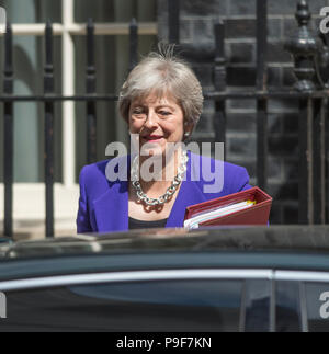 Downing Street, London, UK. 18 July, 2018. British Prime Minister Theresa May leaves Downing Street to attend the final Prime Ministers Questions at the Houses of Parliament before summer recess. Credit: Malcolm Park/Alamy Live News. - Stock Photo