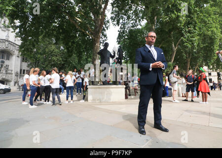London UK. 18th July 2018. British Conservative Party MP, James Cleverly stands in front of the statue of  Nelson Mandela in Parliament to celebrate the centenary of  former President of South Africa who died in 2013 and who led the struggle against the Apartheid regime Credit: amer ghazzal/Alamy Live News - Stock Photo
