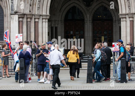 London, UK. 18th July, 2018. Supporters of Tommy Robinson, former leader of the English Defence League, wait outside the Court of Appeal for the outcome of an appeal against two sentences for contempt of court. His legal team argued that the 13-month term of his sentence was 'excessive' and that criminal procedure rules were violated in previous hearings in Canterbury and Leeds and also called for his two contempt sentences to be quashed. Credit: Mark Kerrison/Alamy Live News - Stock Photo