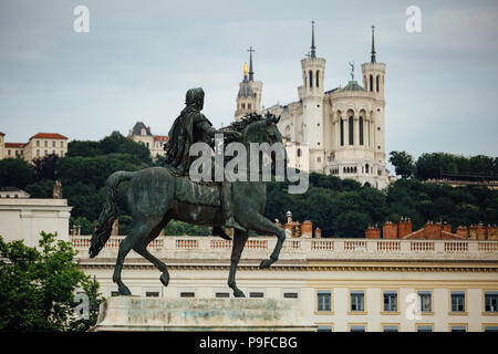 Equestrian Statue of Louis XIV on Place Bellecour in the old town of Lyon. - Stock Photo
