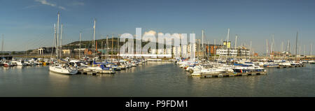 Panoramic view of boats in the marina on the River Tawe in Swansea. T SA1 office development - is a major regeneration project - s in the background. - Stock Photo