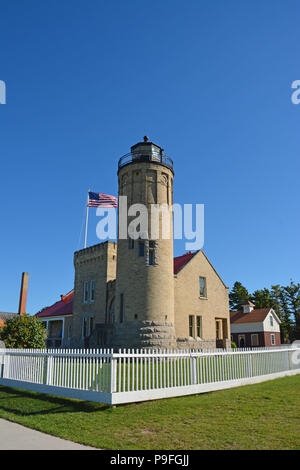 Photograph of the Old Mackinac Point Lighthouse located on the Straits of Mackinac in Mackinaw City, Michigan. - Stock Photo