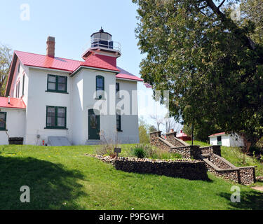 The Grand Traverse Lighthouse (also Grand Traverse Light) on Lake Michigan at the tip of the Leelanau Peninsula. It is a popular tourist destination. - Stock Photo