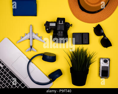 Travel concept advertising accessories on flat lay - Stock Photo