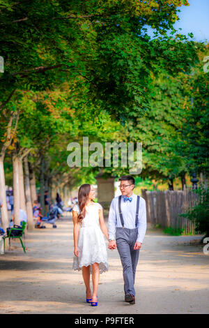 A beautiful Asian couple in Paris, France - Stock Photo