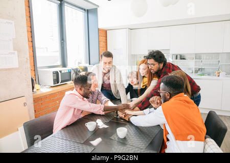 friendly diverse team will support every member in any situation - Stock Photo
