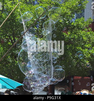 Soap bubbles with street background on Cherry Creek Art Festival in Denver, Colorado - Stock Photo