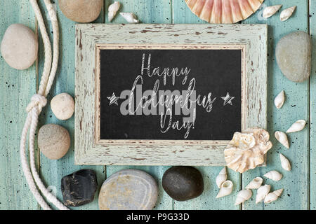 Blackboard With Maritime Decorations on light turquoise wood, text 'Happy Columbus day' - Stock Photo