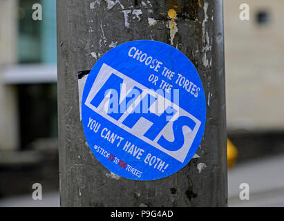 "A sticker reading ""CHOOSE THE TORIES OR THE NHS YOU CAN'T HAVE BOTH"" in Bristol, UK on 30 May 2017, shortly before the general election. - Stock Photo"