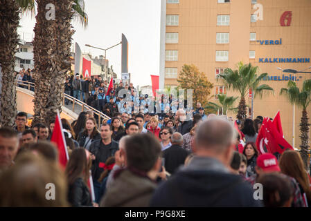 Izmir, Turkey - October 29, 2017: People walking at Kordon Konak Izmir with holding their Turkish flags on hands and some with Ataturk portrait at Rep - Stock Photo