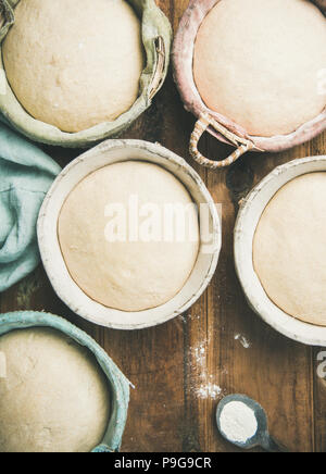 Flat-lay of sourdough for baking homemade bread in baskets