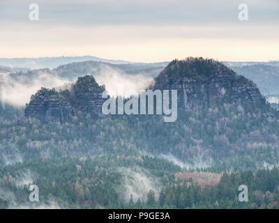 Treetops  silhouette of the top of a hills in the fog, feel the silence of the misty valley in the morning. Fantastic dreamy sunrise on the mountains  - Stock Photo