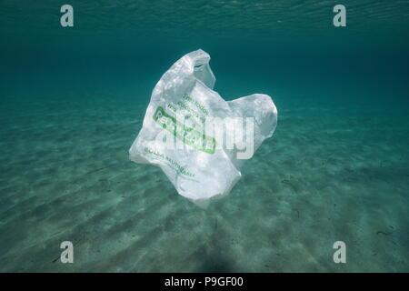 Plastic pollution underwater, a reusable plastic bag adrift in the Mediterranean sea, Almeria, Andalusia, Spain - Stock Photo