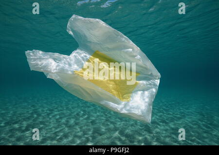 Underwater a plastic bag below water surface in the Mediterranean sea , Almeria, Andalusia, Spain - Stock Photo