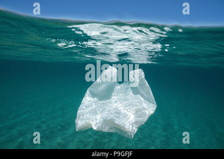 Underwater pollution a plastic bag adrift in the Mediterranean sea below water surface, Almeria, Andalusia, Spain - Stock Photo