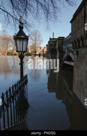 Looking down the flooded steps of Skeldergate Bridge in York, North Yorkshire during Christmas 2015 - Stock Photo