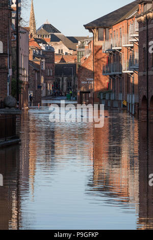 Looking down the flooded streets of Skeldergate in York, North Yorkshire during Christmas 2015 - Stock Photo