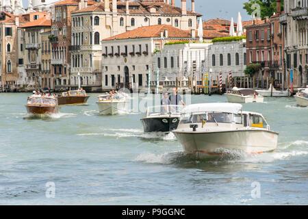Europe, Italy, Veneto, Venice. Few motorboats swimming on Canale Grande (Grand Canal) in Venice near Ponte dell'Accademia, heading Ponte di Rialto. - Stock Photo