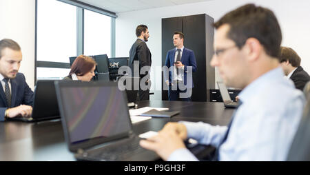 Business people in modern corporate office. - Stock Photo