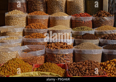 Nuts and dried fruit at market in India - Stock Photo