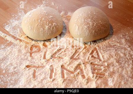 fresh pizza dough, Pizza time - Stock Photo