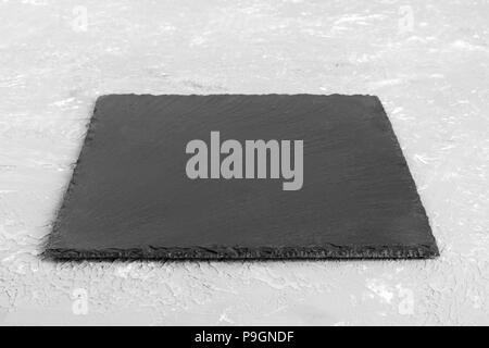 black slate board for serving. perspective view. - Stock Photo