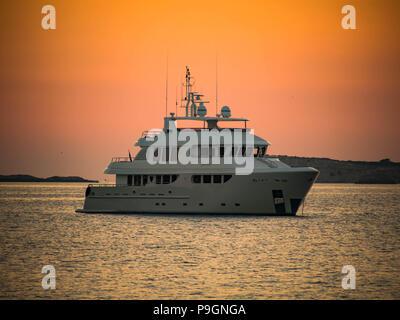 The Super yacht Badido 90 at anchor in San Antonio Bay, Ibiza, Balearic Islands, spain - Stock Photo