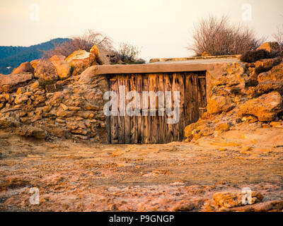 A Fishing Boat Hut on the island of Ibiza, Balearic islands, Spain - Stock Photo