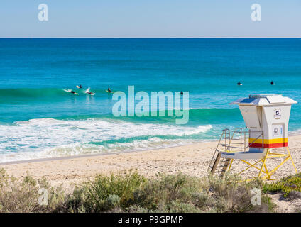 Surfers at Scarborough Beach, Perth, Western Australia - Stock Photo