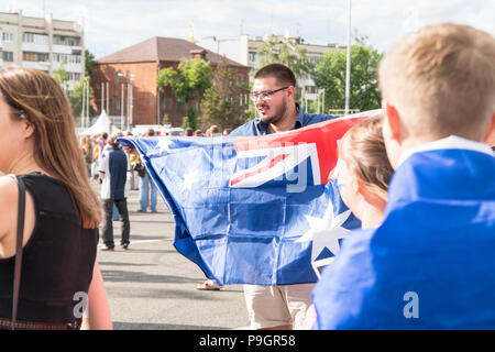Football fans with the flag of Australia in the fan zone - Stock Photo