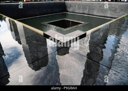 New York City, USA - June 20, 2018: National September 11 Memorial in World Trade Center site - Stock Photo