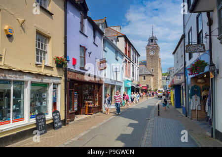 6 June 2018: Looe, Cornwall, UK - Shopping in Fore Street on a warm spring day. - Stock Photo