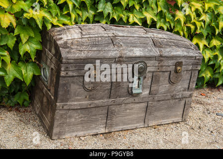 Wooden chest in J. M. Barrie's Birthplace Garden  ( author of Peter Pan ), Kirriemuir Angus, Scotland. - Stock Photo