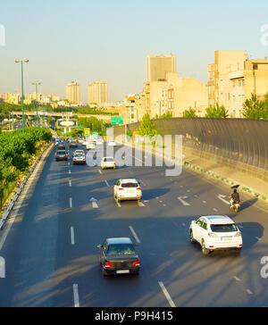 IRAN, TEHRAN - MAY 19, 2017: Car traffic on a highway in Tehran. Tehran is the capital of Iran - Stock Photo