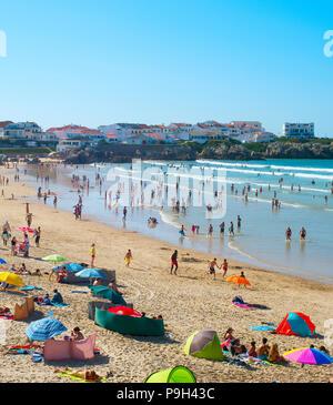 BALEAL, PORTUGAL - JUL 30, 2017: Crowded ocean beach in a high peak season. Portugal famous tourist destination for it's ocean beaches. - Stock Photo