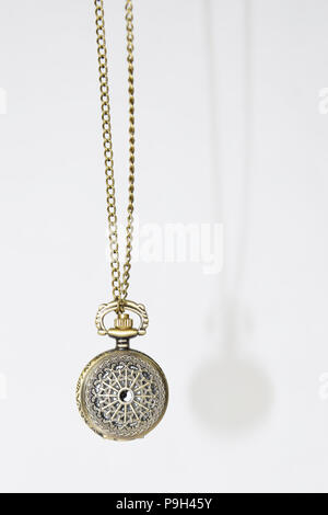Swinging  Ornamented Pocket Watch with Chain - Vintage, Antique Isolated Object, Clock - Stock Photo