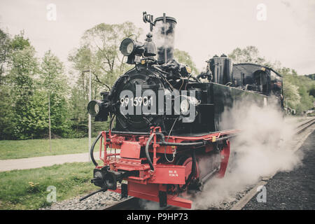 Old Steam Train driving in station - Stock Photo