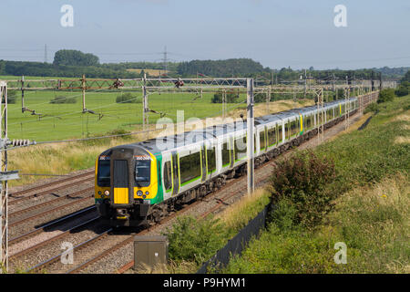 Three class 350 EMUs numbers 350266, 350120 and 350233 forms a West Midlands Trains service at Ledburn Junction on the 30th June 2018. - Stock Photo