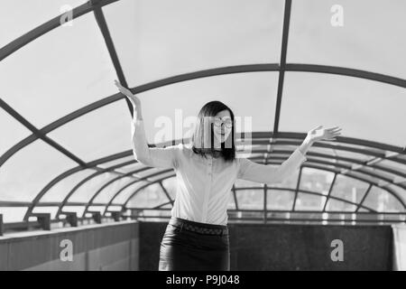 Modern business, female businesswoman working outdoors over a new idea - Stock Photo