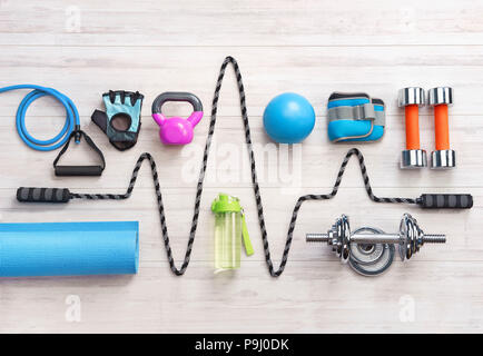 Sports equipment on a white wooden background. Top view. Motivation - Stock Photo