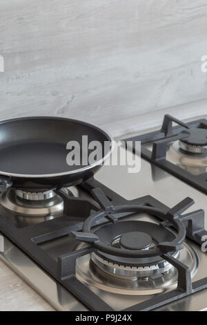 New design of built-in oven and cooker in the kitchen. - Stock Photo