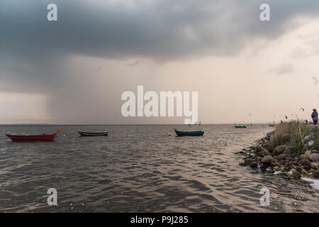 empty boats on the baltic bay with seagulls - Stock Photo