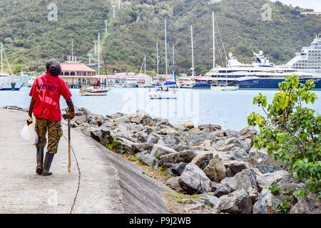 Saint Thomas, US Virgin Islands - April 01 2014: Scene from downtown Saint Thomas, in US Virgin Islands. Boats, Yachts, Cruise Celebrity Ship in the b - Stock Photo