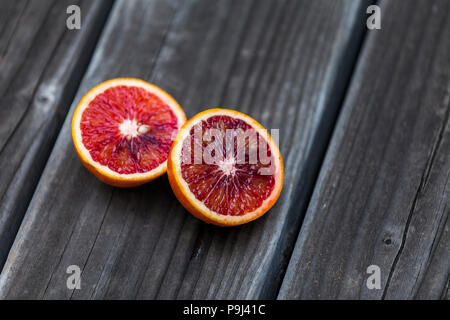 Blood orange and wood. - Stock Photo