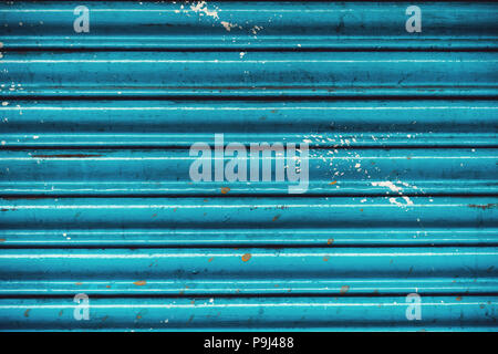 Blue metal facade. Automatic Electric Roll-up Commercial Garage Gate Or Push-up Door In The Modern Building Ground Floor - Stock Photo