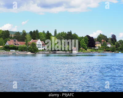 Scenic landscapes of european STEIN am RHEIN town in SWITZERLAND and alpine Rhine River in swiss canton of Schaffhausen with medieval buildings, cloud - Stock Photo