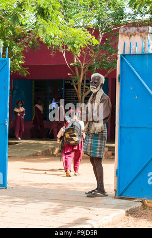 PONDICHERY, PUDUCHERRY, TAMIL NADU, INDIA - MARCH CIRCA, 2018. Unidentified handsome Indian toddler children child with uniform walling to the school. - Stock Photo