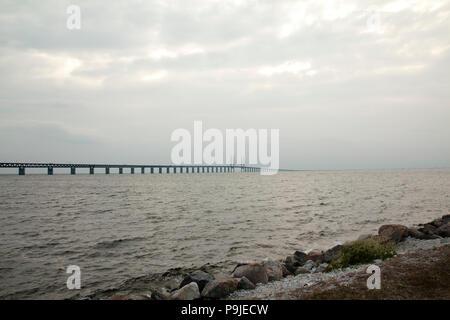 Oresund Bridge on sunset, between Sweden and Denmark, Malmo - Stock Photo